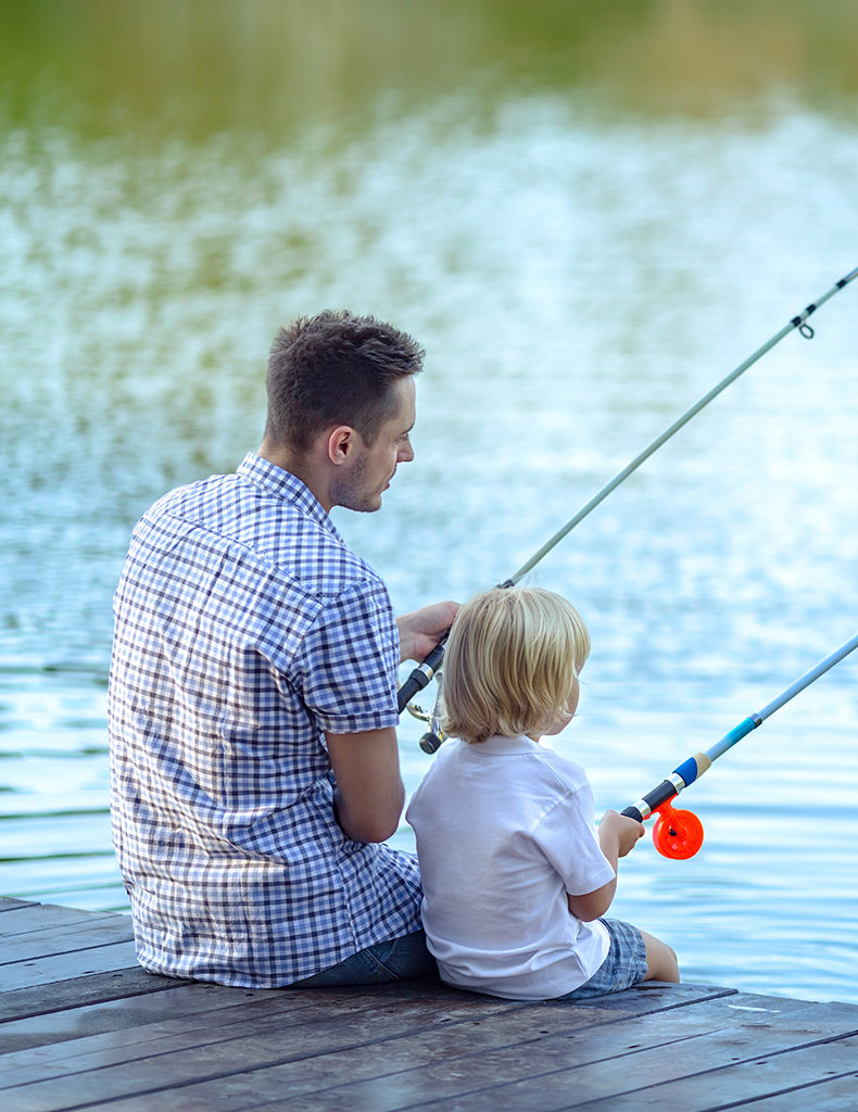 A father fishing with his young child