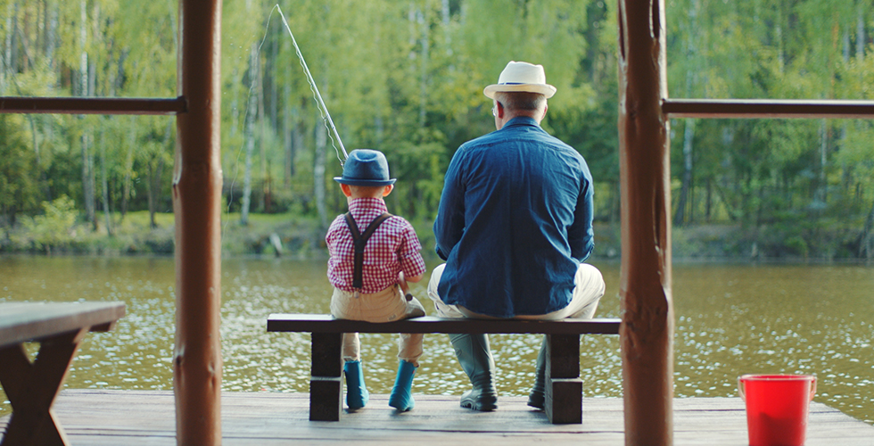 Boy fishing with grandpa
