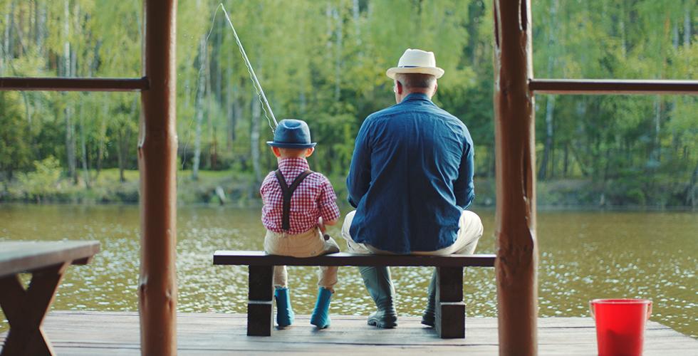 Boy fishing with grandpa